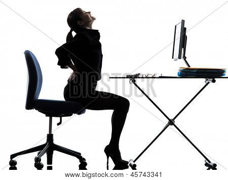 one business woman sitting backache pain  silhouette studio isolated on white background