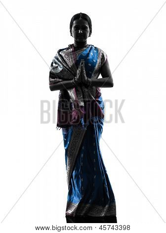 one indian woman saluting praying in silhouette studio isolated on white background