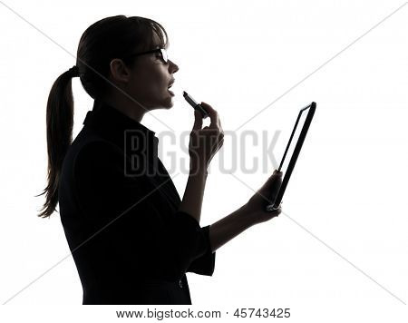 one business woman computer computing digital tablet apply g lipstick  silhouette studio isolated on white background