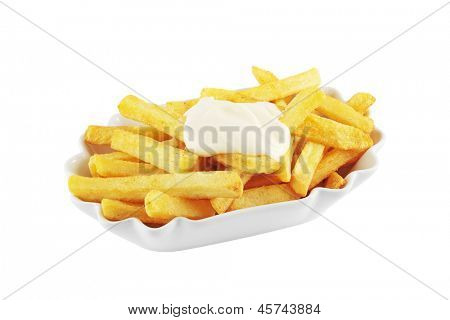 Bowl of french fries topped with mayonnaise isolated on white