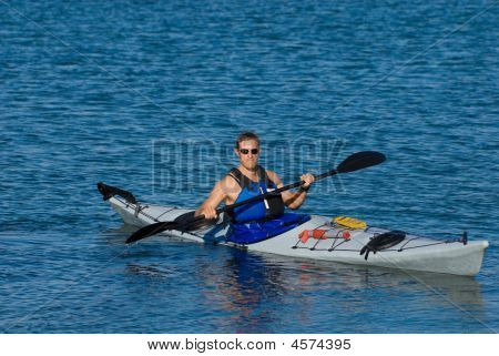 Atheltic Man In A Sea Kayak