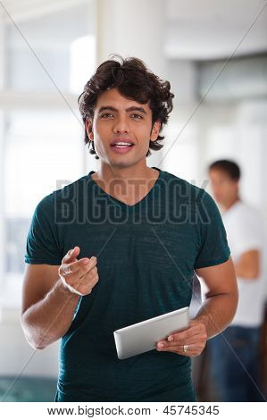 Young Man Holding A Tablet