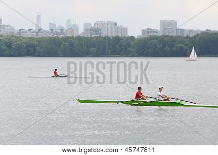 MOSCOW - AUGUST 18: Oarsmen in boats at festival Ekofest 2012 on banks of Stroginsky gulf, on August 18, 2012 in Moscow, Russia.