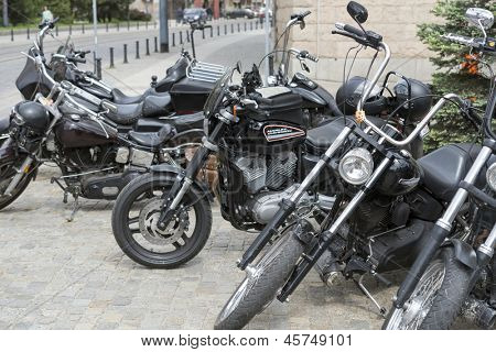 "WROCLAW, POLAND - MAY 18: View of Harley Davidson motorcycle parked in the city during ""Harley-Davidson Super Rally 2013"" on 18, 2013 in Wroclaw, Poland. Europe's largest 5 day motorcycle event"