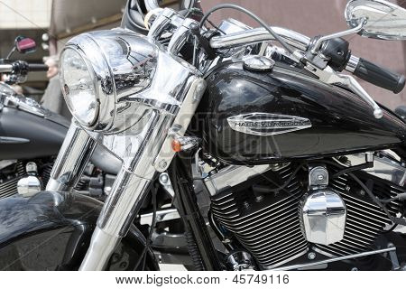 "WROCLAW, POLAND - MAY 18: Detail of Harley Davidson motorcycle parked in the city during ""Harley-Davidson Super Rally 2013"" on May 18, 2013 in Wroclaw, Poland. Europe's largest 5 day motorcycle event"