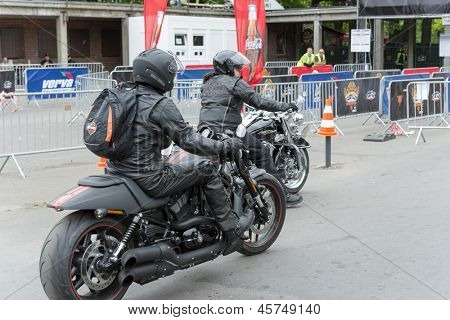 "WROCLAW, POLAND - MAY 18: Harley Davidson motorcycle riders in front of the gate ""Harley-Davidson Super Rally 2013"" on May 18, 2013 in Wroclaw, Poland. Europe's largest 5 day motorcycle event."