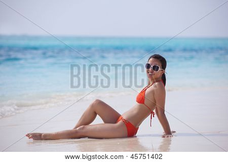 beautifel and happy woman girl on beach have fun and relax on summer vacation  over the sea