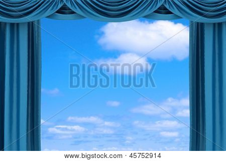 Open blue theater curtain on sky  background