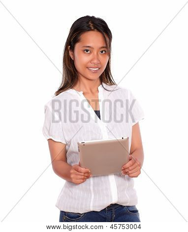 Charming Asiatic Young Woman Using Her Tablet Pc