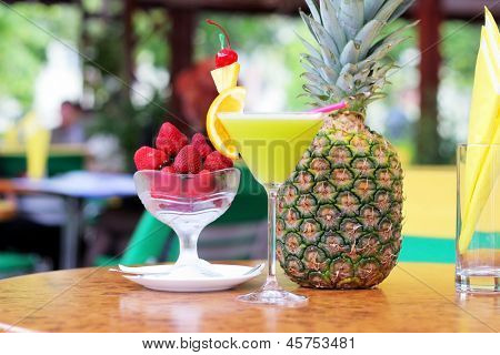 Tropical pineapple cocktail with strawberries