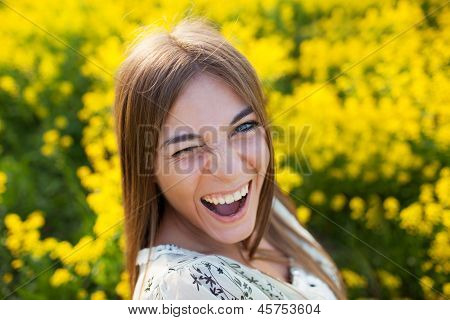 Playful Young Woman Among Yellow Flowers