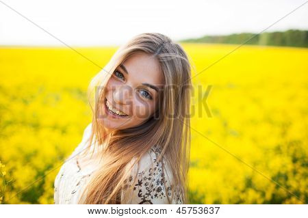Beautiful Young Woman Of Yellow Wildflowers