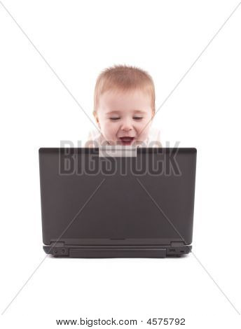 Happy Baby Boy Looking At Laptop