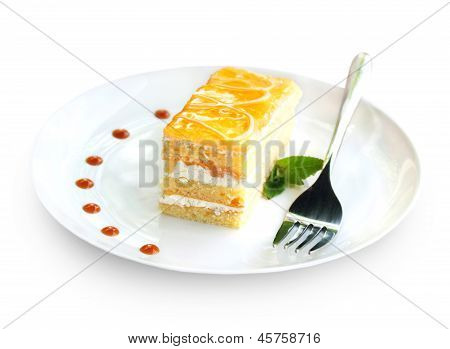 A Piece Of Fruit Cake With Curd Cream