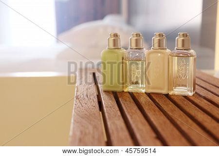Four Cosmetic Bottles In A Washroom