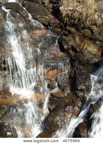 Waterfall Over Colorful Rock