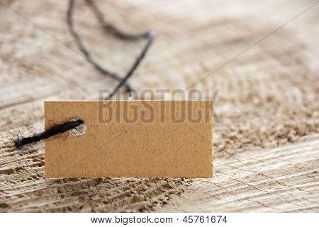 Brown Label Tag On Wood
