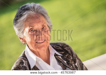Beautiful portrait of a senior woman smiling outdoors