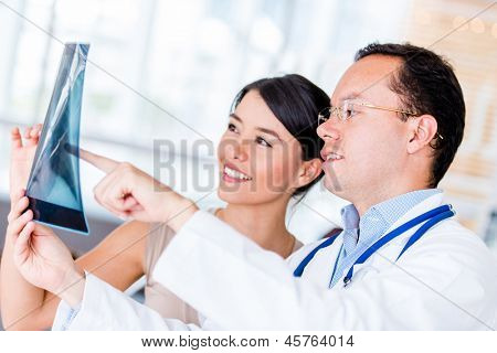 Doctor talking to a patient and holding an x-ray