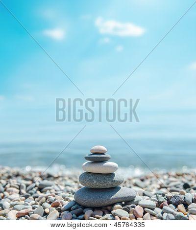 heap of stones like zen near sea. soft focus