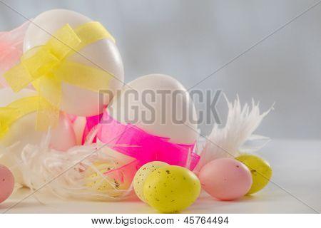 White easter egg in feather