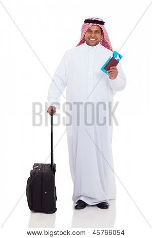 smiling middle eastern man with travel luggage and air ticket isolated on white