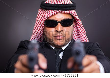 dangerous arabian mafia man with handguns