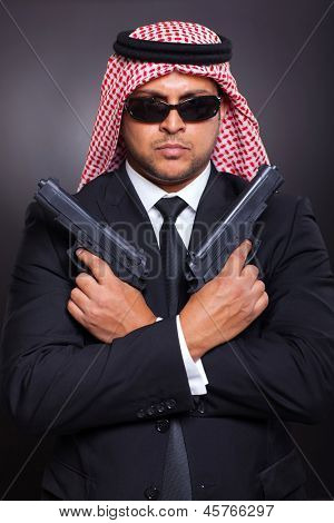 arabic secret service agent holding two handguns