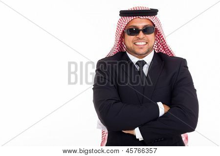 wealthy arabian businessman wearing shades over white background
