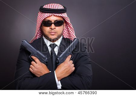 arabian mafia with two handguns on black