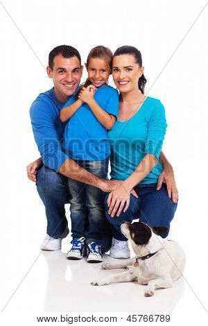 smiling little girl with her parents and their pet dog isolated on white background