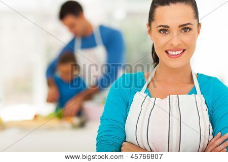 pretty young mother in front of family in kitchen