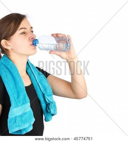 Woman In Sportswear Drinking Water