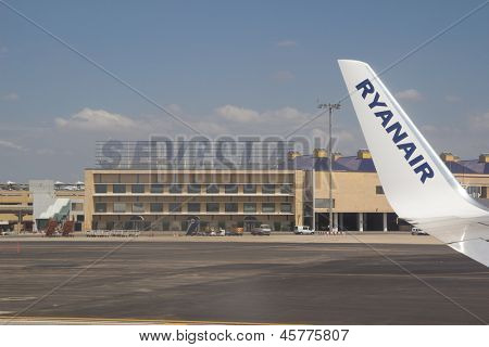 SEVILLE, SPAIN - MAY 14: A Ryanair aircraft taxing in the Seville Airport in Seville, Spain on May 14, 2013. Ryanair announced plans to target European to USA flights with low prices.