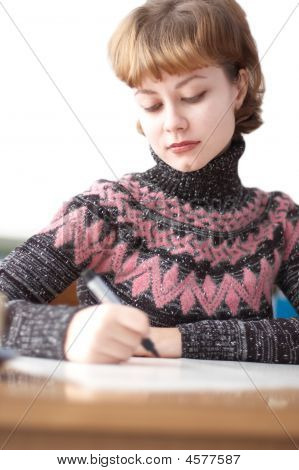 Young Attractive Woman Writing