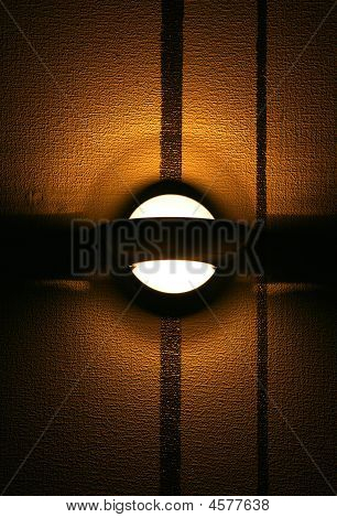 Lamp On A Brown  Wall