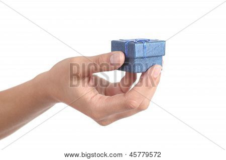 Woman Hand Holding A Gift Box