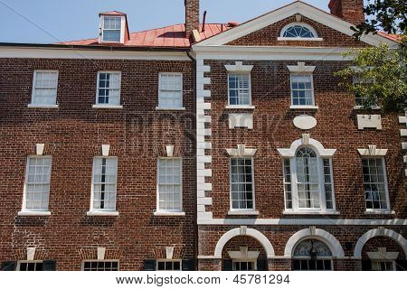 Classic Brick Building With White Cornice