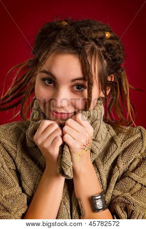 Beautiful Young Woman With Dreadlocks On A Red Background