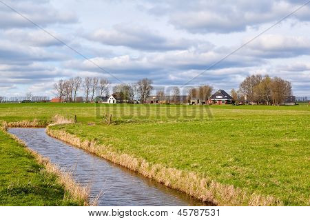 Typical Dutch Farmland With Canal