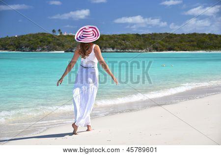 Girl on the desrt beach. Exuma, Bahamas