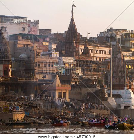 VARANASI, INDIA -23 MARCH: Manikarnika Ghat on the banks of Ganges river on March 23, 2013 in Varanasi, Uttar Pradesh, India. Manikarnika Ghat is the most auspicious place for Hindu to be cremated.