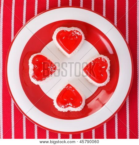 cheesecakes in heart on a striped tablecloth.