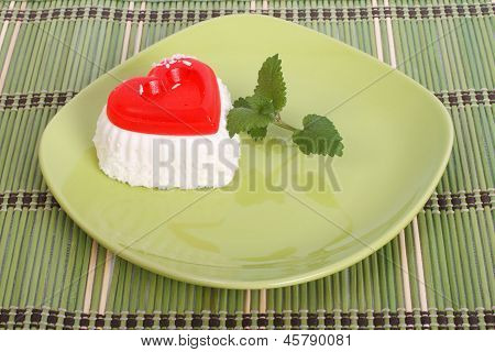 cake with mint on green plate