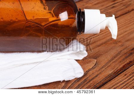 Liquid soap dispenser and a white towel