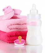 Bottle for milk with towels and nipple isolated on white