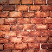 stock photo of swastika  - Nazi swastika on the brick wall - JPG