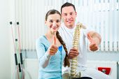 Physiotherapist and patient in a practise after a successfully treatment is the diagnosis a clear im