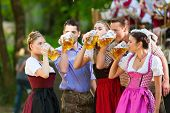 stock photo of lederhosen  - In Beer garden in Bavaria - JPG