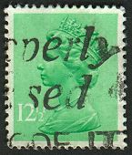 UK-CIRCA 1982:A stamp printed in UK shows image of Elizabeth II is the constitutional monarch of 16